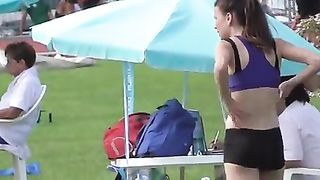 Athletic girl runs around the track in tight clothes--_short_preview.mp4