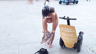 Bare beauty gets dressed on public sidewalk--_short_preview.mp4
