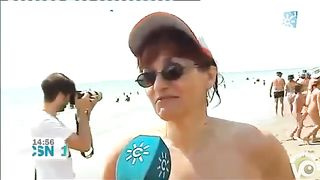 Mature Spanish nudists walk around the beach completely naked--_short_preview.mp4
