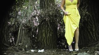 Elegant bridesmaid in a yellow dress enjoys urinating outside--_short_preview.mp4