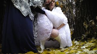 Bride struggles with her wedding dress as she pees in the woods--_short_preview.mp4