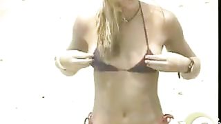 Bikini girl nipple slip on a breezy beach day--_short_preview.mp4