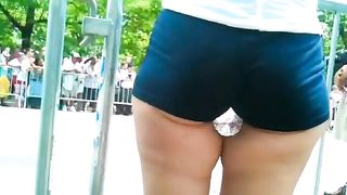 Lustful cutie holds a bottle of water between her strong thighs--_short_preview.mp4