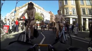 Group of nudists cycle through a town in their birthday suits--_short_preview.mp4