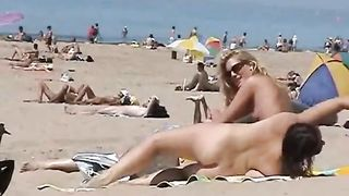 Sunny day at the public beach with two nudist girls--_short_preview.mp4