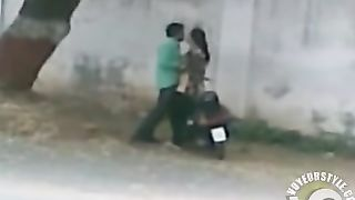 Pakistani couple bangs on a moped by the side of the road--_short_preview.mp4