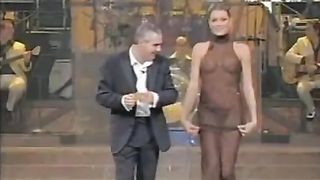 Extravagant TV presenter in the transparent dress--_short_preview.mp4