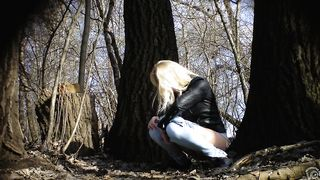Irresistible girl holds onto jeans while piddling in the city park--_short_preview.mp4