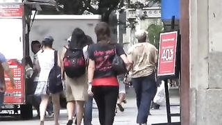 Beautiful girl on the street flirts with a smile--_short_preview.mp4