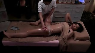 Horny masseuse fingers a beautiful Asian client to orgasm--_short_preview.mp4