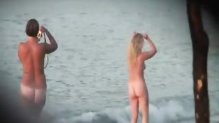 Naked ladies pose for pictures on the beach--_short_preview.mp4
