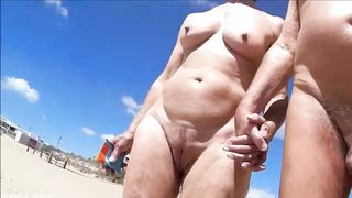 Group of mature nudists walks around the beach naked--_short_preview.mp4