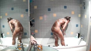 Long-haired babe soaps up while showering--_short_preview.mp4