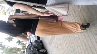 Slim charming lady walks around in a skirt that accentuates her firm buttocks--_short_preview.mp4