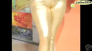 Wide hips Latina woman in shiny gold leggings--_short_preview.mp4