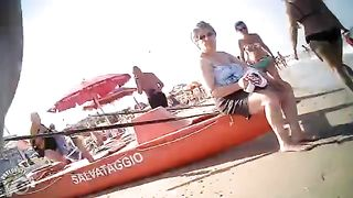 Tube top bikinis on two girls at the beach--_short_preview.mp4