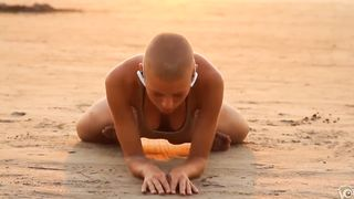 Bald beauty doing yoga by the sea--_short_preview.mp4