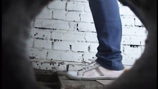 White lady in blue jeans pisses in a dirty shabby toilet room--_short_preview.mp4