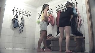 Pale skin and bronze skin ladies in the locker room chaning clothes--_short_preview.mp4
