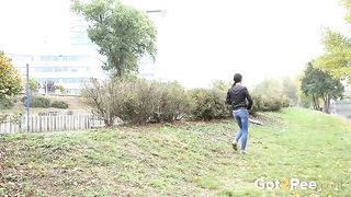 Brunette sexy sweetheart in jeans pissing behind the bush--_short_preview.mp4