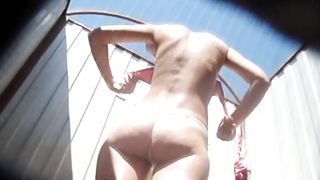Slender white caramel skin babe in the beach cabin filmed nude from behind--_short_preview.mp4