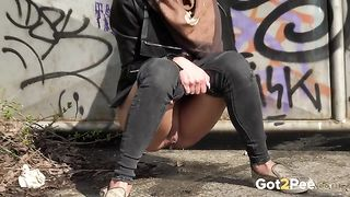 Sweet brunette chick pissing behind the gates outside--_short_preview.mp4