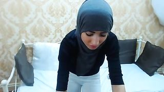 Gal in hijab and legging rubs her butt with a big dildo--_short_preview.mp4