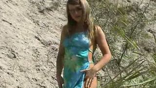 Adorable all natural new blonde girl undresses on the beach--_short_preview.mp4