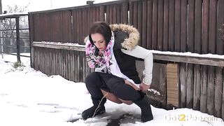 Brunette girl in the snow pissing behind the fence--_short_preview.mp4