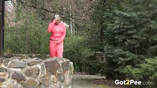 Blonde sassy bimbo in pink sport outfit pisses behind the stone well--_short_preview.mp4