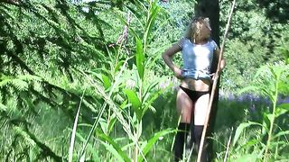 Blonde amateur curly haired chick in the forest pisses under the tree--_short_preview.mp4