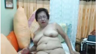 Mature short haired granny from some Asian country exposes her tits--_short_preview.mp4