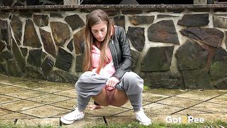 Naturally hot and pretty girl in grey pants wanna pee outdoors--_short_preview.mp4