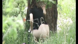 Redhead teen with pale skin ass pisses in the woods behind the tree--_short_preview.mp4