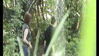 Redhead white girl hides behind the tree and pisses in the woods--_short_preview.mp4