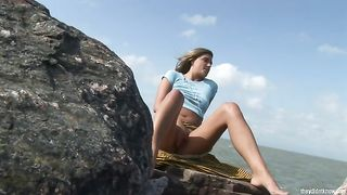 Desiring blonde babe takes off her panties sitting on the rock and rubs her twat--_short_preview.mp4