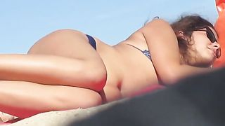 A couple of hot curvaceous girls sunbathing on the beach--_short_preview.mp4