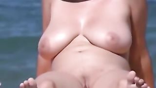 Big boobed MILF tanning on a beach totally naked--_short_preview.mp4