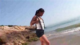 My stunning brunette girl brags off her sexy tanned body on the beach--_short_preview.mp4