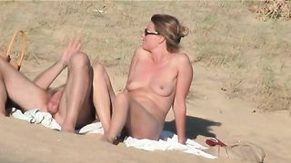 Mature couple having a foreplay on nude beach - spy camera video--_short_preview.mp4