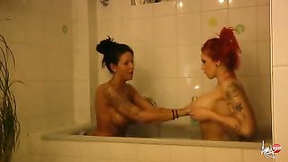 Two hot and sexy babes bathing in a tub together--_short_preview.mp4