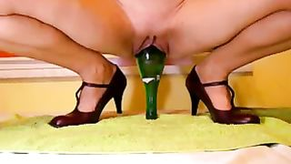 Filthy mature woman stretching her vagina with a glass bottle--_short_preview.mp4