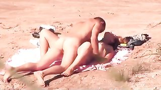 One insatiable couple is making love on the beach--_short_preview.mp4