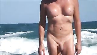 Blonde shemale with weird tits gets caught on my hidden cam on a beach--_short_preview.mp4