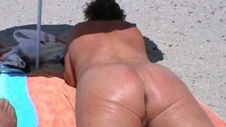 BBW wife takes sun bath on the nude beach exposing her greasy booty--_short_preview.mp4