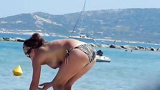 Hidden cam video with a topless brunette sunbathing on a beach--_short_preview.mp4