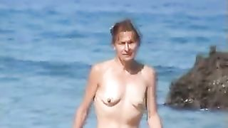 Kinky ugly skinny bitch exposes her small tits outdoors on the beach--_short_preview.mp4