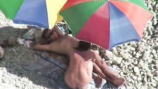 Wondrous tanned big racked auburn lady flashes her titties on the beach--_short_preview.mp4