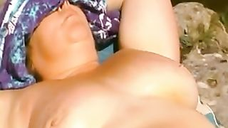 Lies on the rock exposing her sexy titties and her pussy--_short_preview.mp4