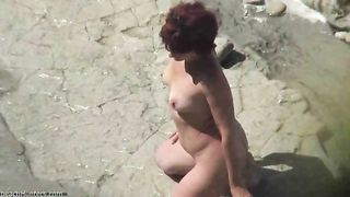 Sexy milf on the beach with her partner on photo session--_short_preview.mp4
